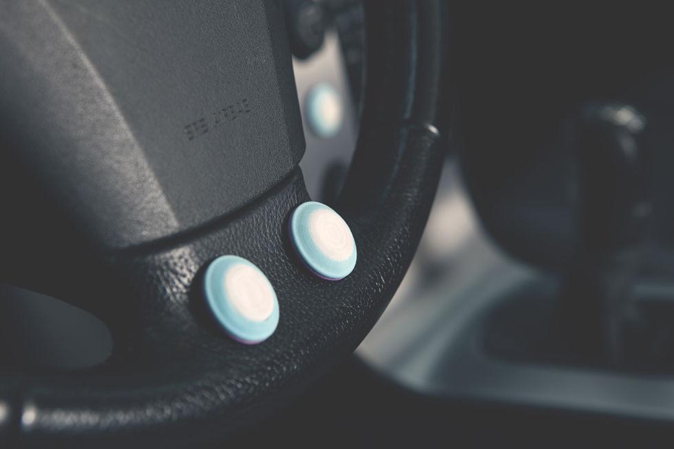 Styr telefonen med en Bluetooth-knapp