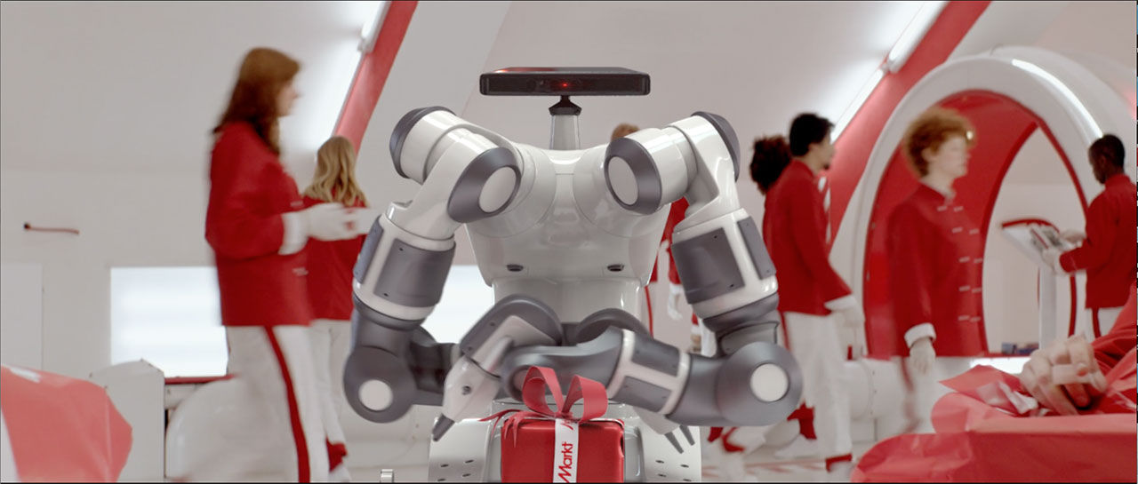 Roboten YuMi slår in julklappar