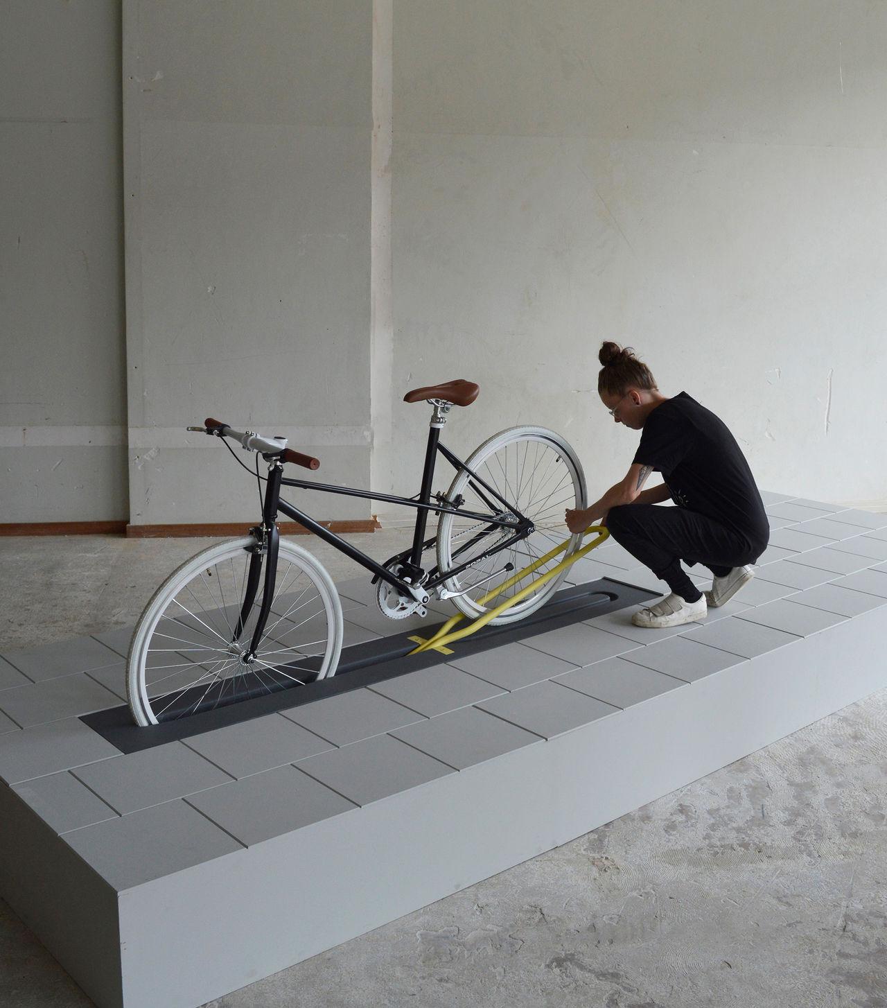 Cykelställ som gömmer sig i marken