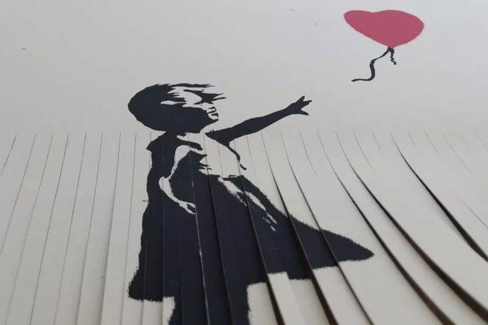 Idiot strimlade sönder sin egen Banksy-konst